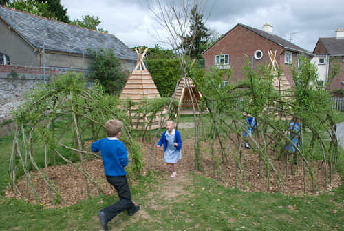 Pallets + Logs = Teepee for a Kids Playground Fun Pallet Crafts for KidsPallet Sheds, Pallet Cabins, Pallet Huts & Pallet Playhouses
