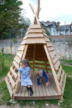 Pallets + logs = teepee for a playground