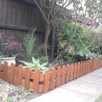 Repurposed Pallets Into Fence