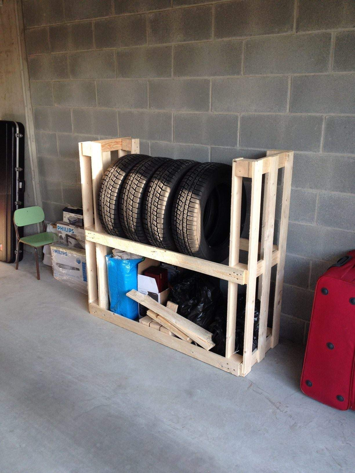 Tire rack from upcycled wooden pallets pallet ideas - Armoire de rangement pour garage ...