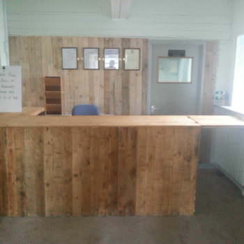 Counter With Pallet & Cladded Wall Backdrop