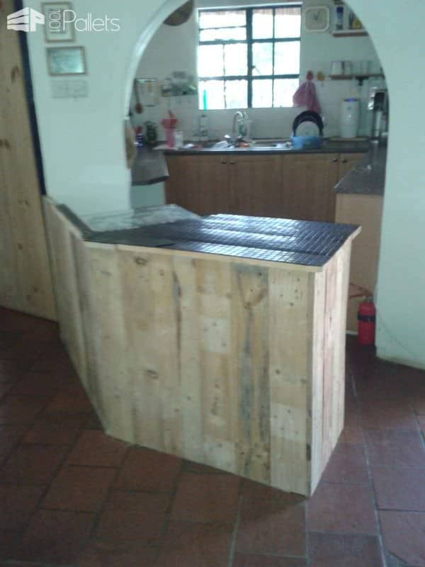 Pallet Kitchen Counter - wood is installed, and the top is tiled in a beautiful dark tone to compliment the light pine and poplar woods.