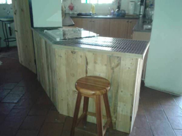 Add store-bought (or homemade) bar stools, and your Pallet Kitchen Counter is complete!