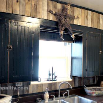 Black Chalkboard Cabinets With Pallet Board Backsplash