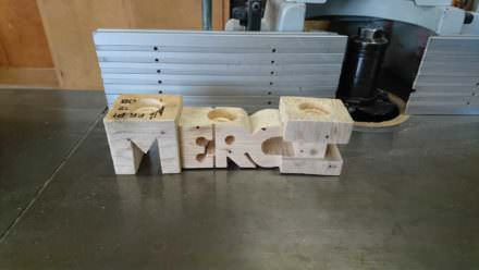 Candlestick in the Form of Letters Made out of Pallet Blocks
