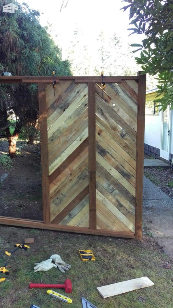 Backyard Fence Made with Repurposed Pallets Pallet Fences