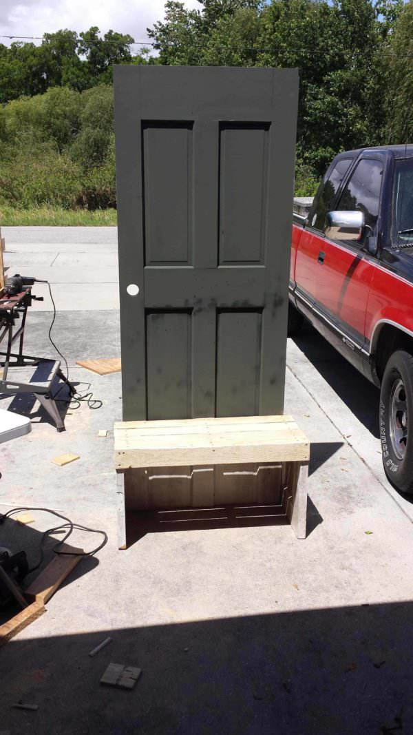 Old Repurposed Door with Pallet Wood Into Entrance Seat