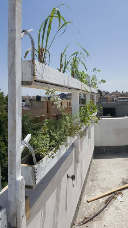 Vertical Structure with Hanging Plants Pots from Pallets