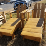 Two Adirondack Chairs With Foot Rests