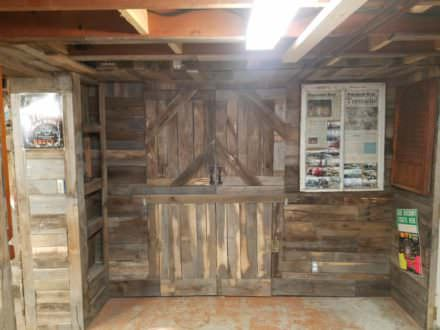 Ultimate Pallet Man Cave Features Epoxy Penny Bar