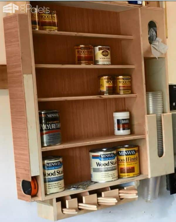 Recycled Wood Finishing Station - this handy cabinet is made from upcycled wood, and it has places for various sizes of stain cans, paint pucks, paint brushes, and even a cup dispenser and rag dispenser. A great addition to your workshop or man cave!
