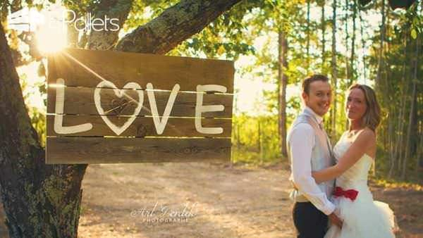"Wedding Pallet Craft Ideas - pallet sign as a wedding backdrop with the word ""love""."
