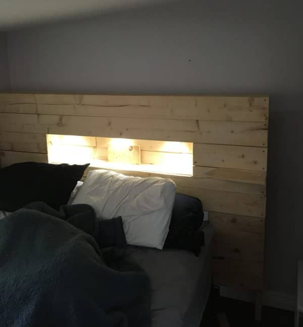 This LED-Lit Pallet Wood Headboard is gorgeous, and eliminates the need for bedside lamps that get knocked over.