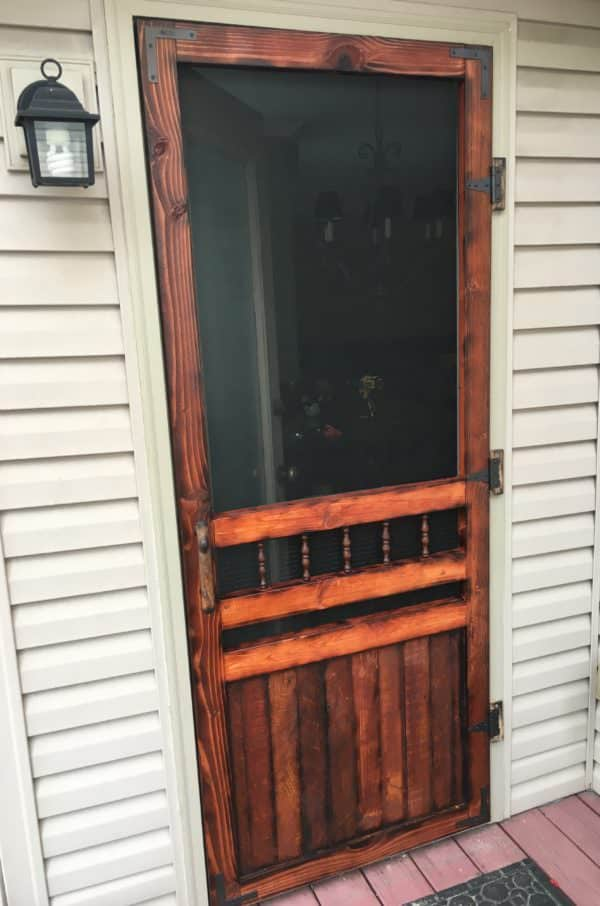 This Pallet Wood Screen Door is much more attractive compared to the aluminum flimsy models you get at the home centers for 100+ dollars!