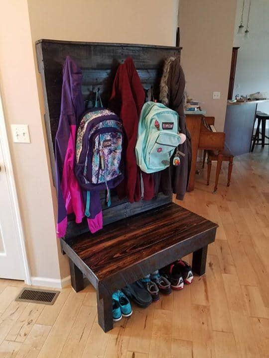 This Pallet Hallway Bench makes it easy to organize your coats, backpacks, and even tuck your shoes away underneath.