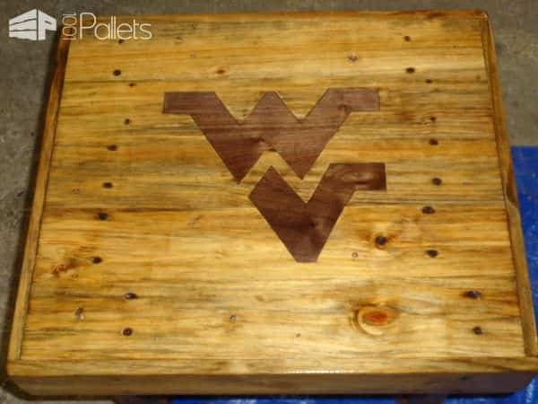Pallet Deck Table features a walnut inlay of a sports team logo.