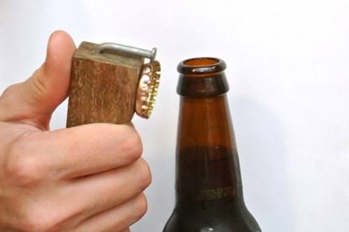This is certainly not a Weird Wood creation - it is GENIUS! Now be the life of the party or the camping trip when someone forgets to bring the bottle opener.