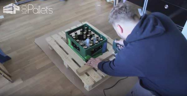 Checking measurements before cutting pieces for the Mobile Pallet Bar with a jigsaw.