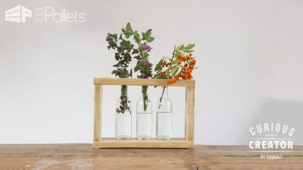 Pallet Glass Vase Stand can be filled with clear beer or soda bottles. Perfect in case one ever got broken!