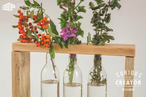 Use this Pallet Glass Vase Stand to feature seasonal herbs and flowers.
