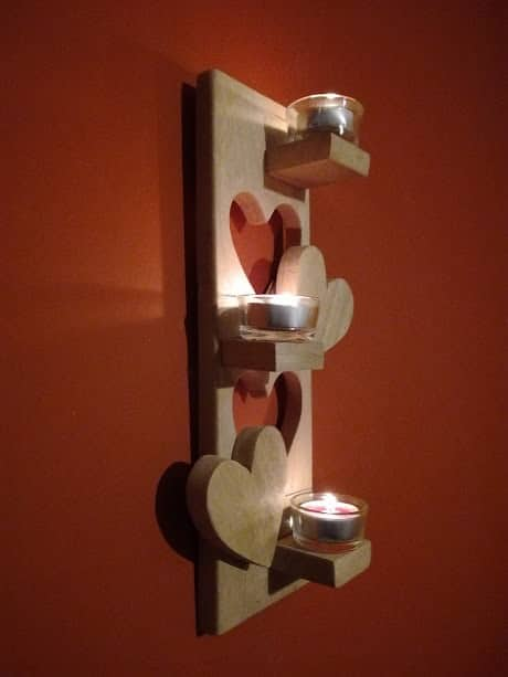You could make a straightforward pallet tea light holder or you could add some style like this Pallet Tea Light. It has three small shelves, along with two cut-out pieces in heart shapes.