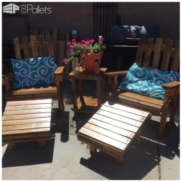 This Adirondack Chairs Patio Set consists of two chairs, two ottomans/footrests, and a side table to share between them. All made from pallet wood.