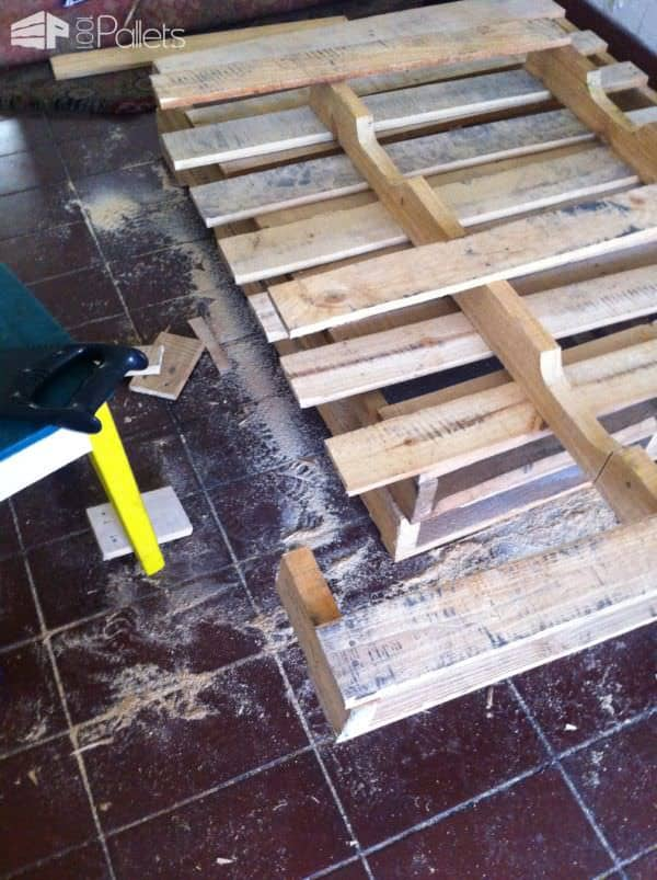 Pallet Wood Bed/Headboard began with several pallets that were dismantled; others were kept whole for the pedestal.