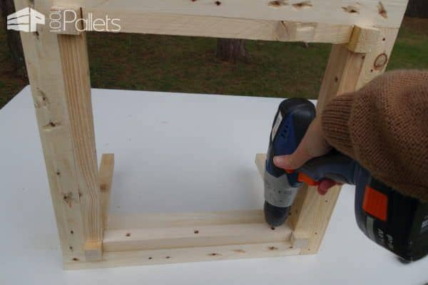 Using screws, pre-drill first, and assemble the frame of this Petite Pallet Planter.