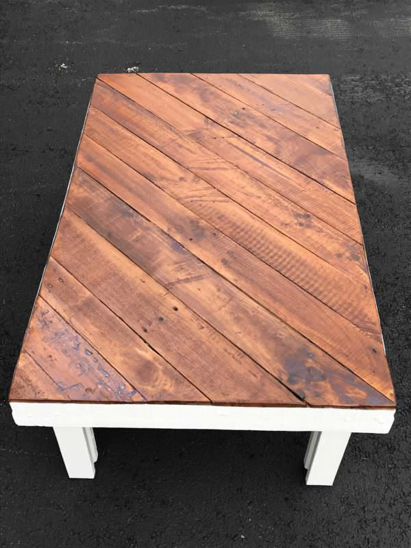 Bias Pallet Coffee Table features a diagonally-installed coffee table top with classic white legs and frame for a modern look..