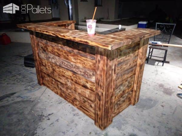 Torched Pallet Bar features a woodburned finish.