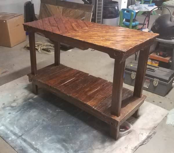 This Pallet Entryway Table has a gloss sealant coat to protect it.