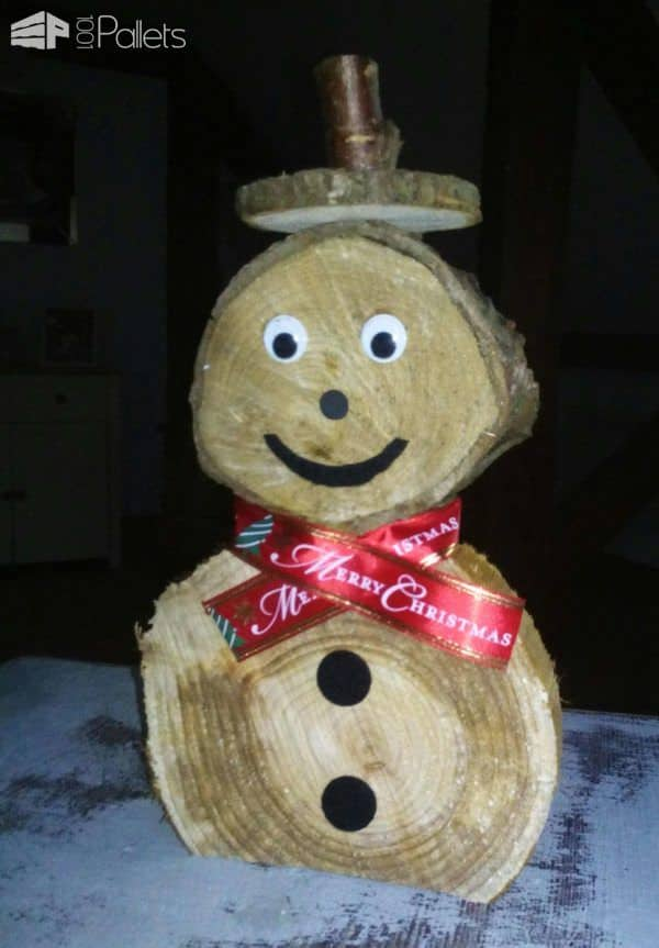 Use slices of branches to create your own version of our Pallet Snowman Ideas.