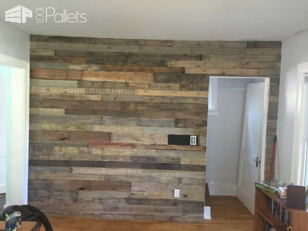Pallet Wood Walls can be left in the weathered, silvered color or you can stain them specifically to create the look.