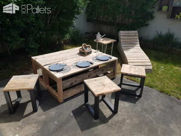This Convertible Pallet Lounge Set is attractive enough to be in a catalog. The set consists of a lounger, side table, three stools, and the convertible table/bench conversion piece.
