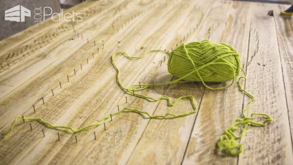 This Pallet Cactus String Art can be made with leftover skeins of yarn, or change the design to any shape you wish to match the yarn you have.