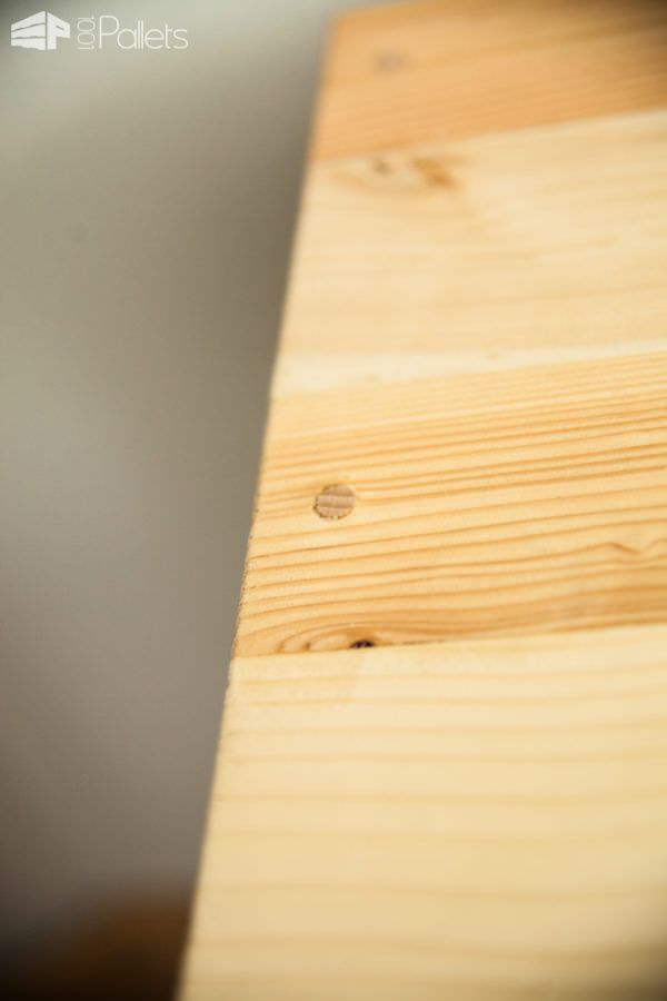 Plane wood and add beautiful wood plugs to hide the hardware to create a finished look.