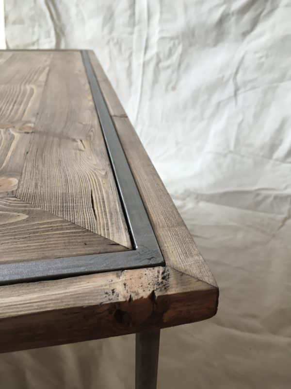 Don't be afraid to use wood with character and flaws to add interest in your own Sleek Pallet Coffee Table.