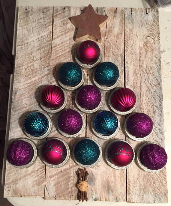 make a pallet christmas tree by making a pallet back then gluing sparkly ornaments to