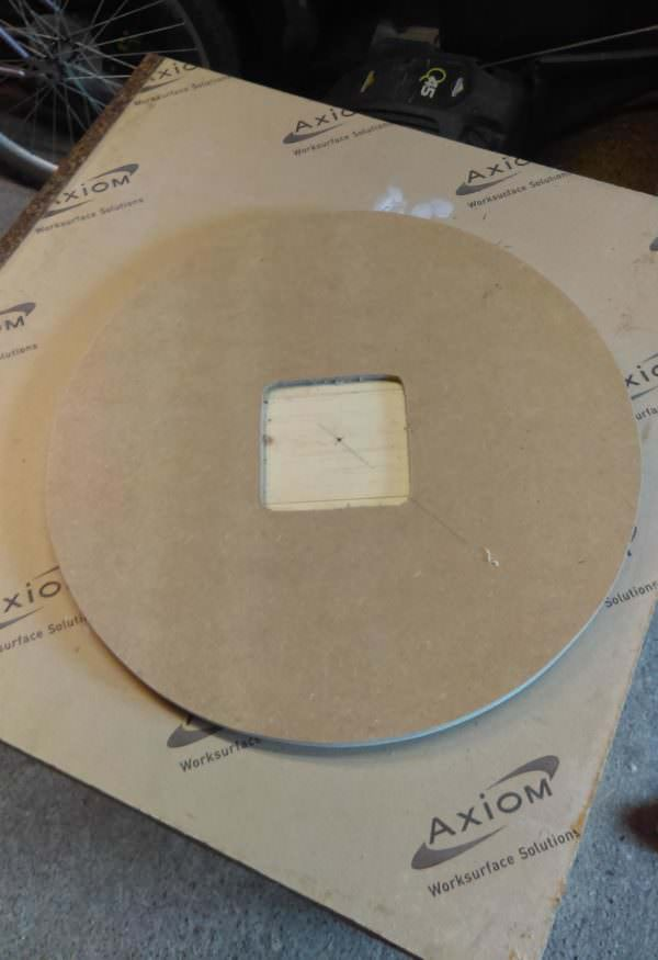 Cut a hole in the backer MDF for the clock motor for your Pallet Wrist Watch Clock.