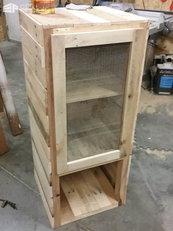 The Pie Safe Pallet Cabinet is complete; door is installed, and the project is ready for staining.