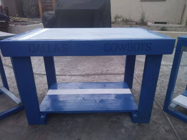 I used a router to carve out the team name on the side of this Cowboys Pallet Table Set.