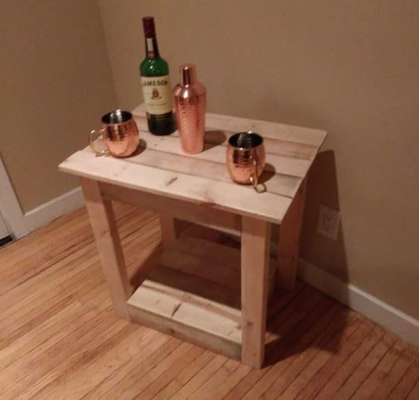 Pallet Furniture Pieces include this pallet end table that can be used as a side table to display your collectibles.