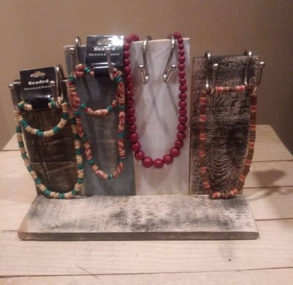 Create Rustic Pallet Furniture Pieces like this rustic jewelry holder.