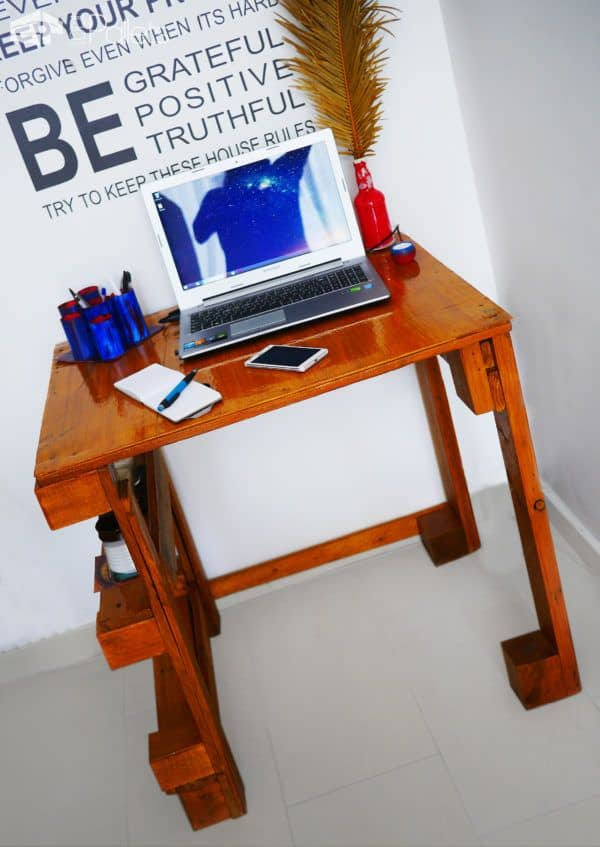 Add a warm stain and high-gloss polyurethane, and create a beautiful finish on this Easy Pallet Desk.