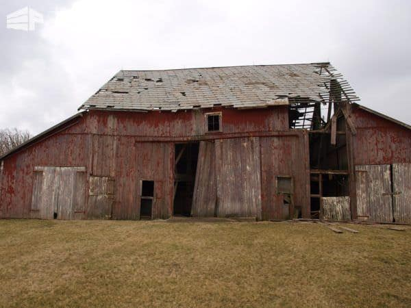 Offer to tear down an old barn in exchange for keeping the free wood.