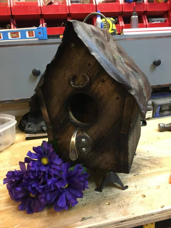 This Barn Style Birdhouse features a bent spoon as a perch.