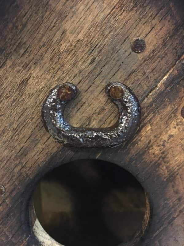 Add color to your Barn Style Birdhouse by lightly charring or burning the wood. This birdhouse features metal accent pieces like this drawer pull.