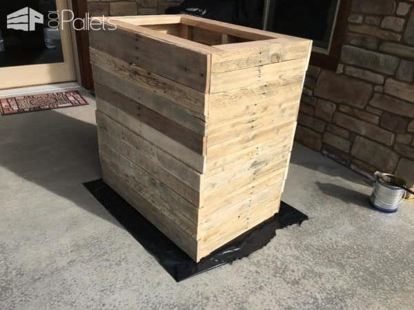 Cover the Pallet Kindling Box with pallet deck boards.