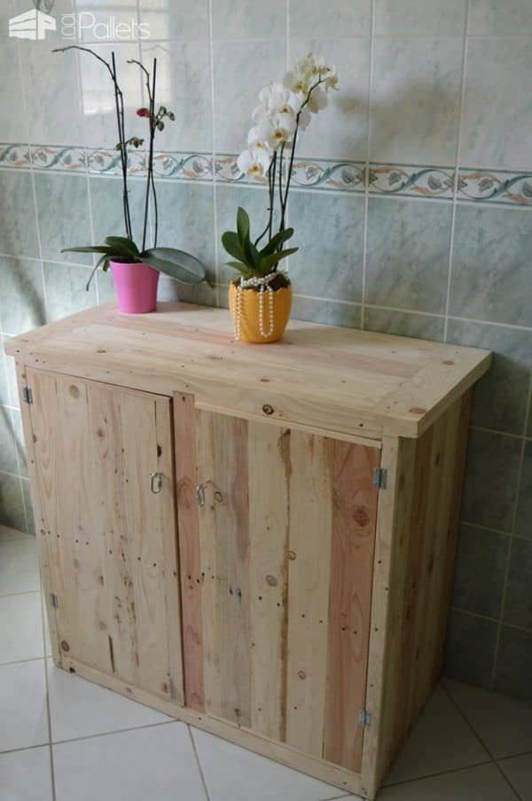 DIY Pallet Furniture like this little cabinet has roomy shelves, a nice top for displaying your collectibles, and would work in any room of the house.