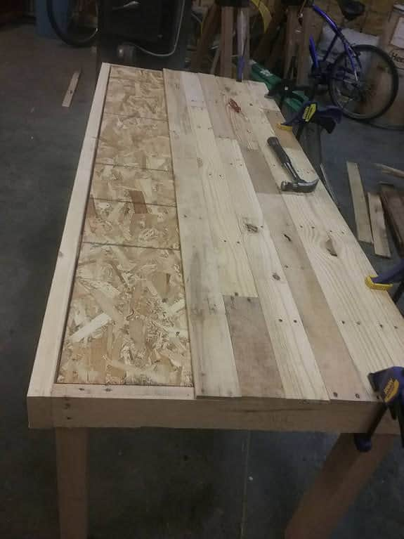 "This Pallet Dining Table has a 1/2"" OSB plywood base."